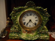 antique ansonia china clock,  porcelin face,  runs