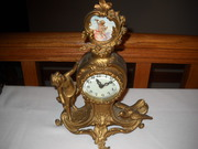 antique new haven statue clock with cupid and bird on it runs